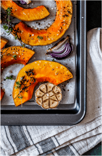 Pumpkin slices on an oven tray
